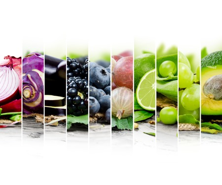 Photo of fruit and vegetable mix with green and blue colors and white space Standard-Bild