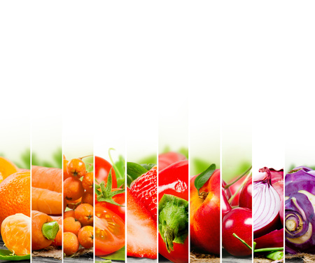 Photo of fruit and vegetable mix with orange and red colors and white space Standard-Bild