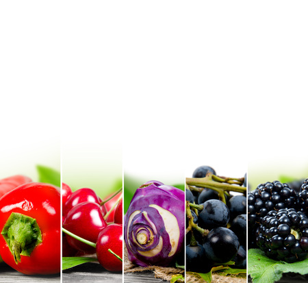 Photo of fruit and vegetable mix with red and blue colors and white space Stock Photo