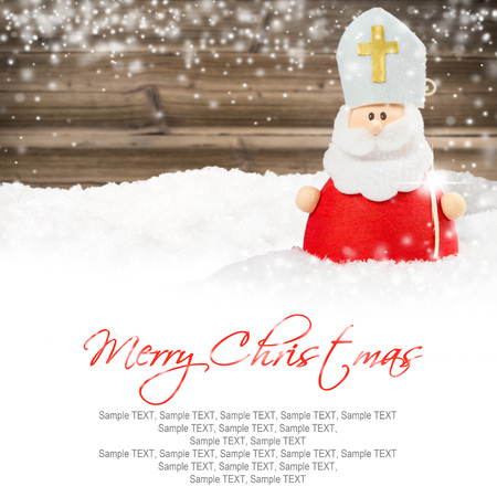 saint nicolas: Photo of Saint Nicolas on wooden board background with falling snow and white space Stock Photo