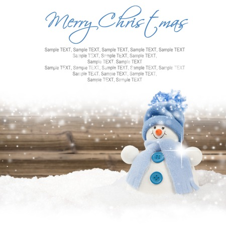 frosty the snowman: Photo of blue snowman on wooden board background with falling snow and white space