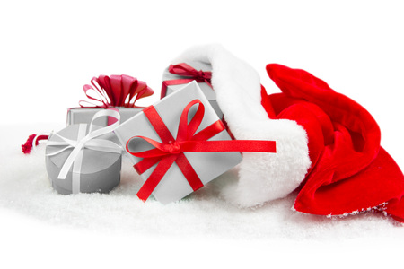 Photo of Santa bag and gifts isolated on white