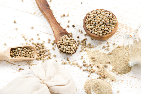 white pepper: Photo of bowls full of white pepper seeds and powder on white wooden surface