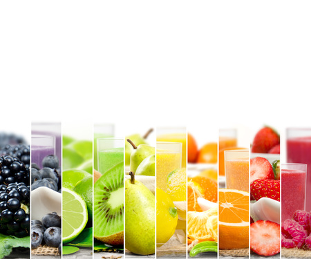 rainbow cocktail: Photo of colorful mix stripes with fruit, slices and drink; healthy food and drink concept; white space for text Stock Photo