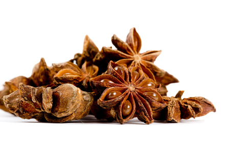 badian: Photo of star anise heap isolated on white