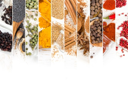 Top view of mixed colorful spice scattered on white wooden surface