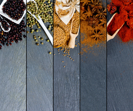 indian mustard: Top view of mixed colorful spice scattered on gray slate tile surface
