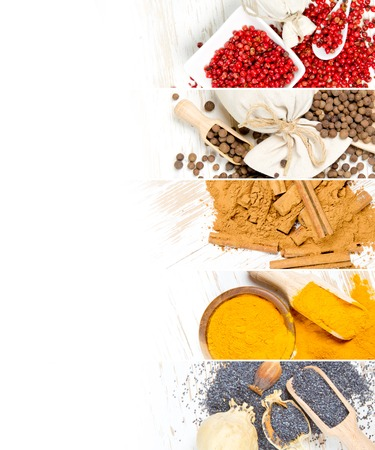 Top view of mixed colorful spice scattered on white wooden surface; white space for text Stock Photo