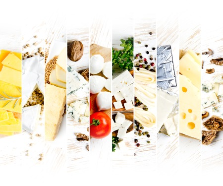 Top view of various kinds of cheese abstract mix with spice and herbs on wooden boards; white space for text Stock Photo