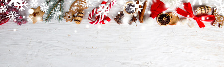 Photo of Christmas decorations and spices on white wooden background
