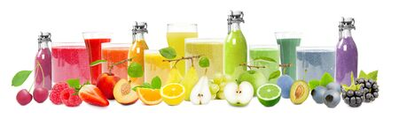 Collection of fruits with slices and a glass of juice in rainbow colors, healthy food and drink concept; isolated on white background