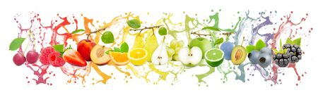 Collection of fruits with slices and juice splash in rainbow colors, healthy food and drink concept; isolated on white background