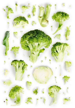 Large group of green broccoli pieces isolated on white background.