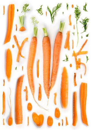 Large group of orange carrot pieces isolated on white background. Stock Photo