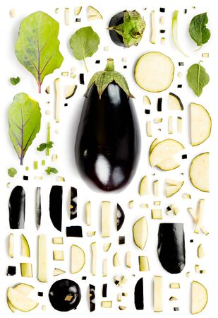 Large group of eggplant pieces, slices and leaves isolated on white background. Seamless abstract pattern. Vertical composition.