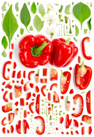 Large collection of red pepper vegetable pieces, slices and leaves isolated on white background. Top view. Seamless abstract pattern. Stock Photo