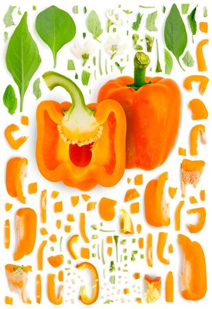 Large collection of orange pepper vegetable pieces, slices and leaves isolated on white background. Top view. Seamless abstract pattern.
