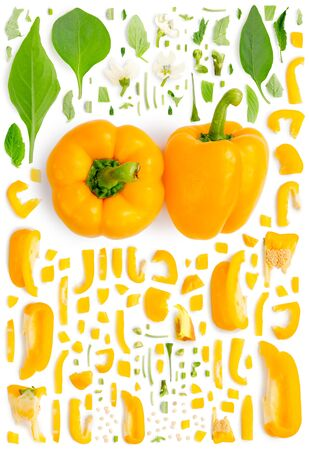 Large collection of yellow pepper vegetable pieces, slices and leaves isolated on white background. Top view. Seamless abstract pattern.