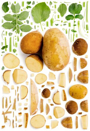 Large collection of potato vegetable pieces, slices and leaves isolated on white background. Top view. Seamless abstract pattern.