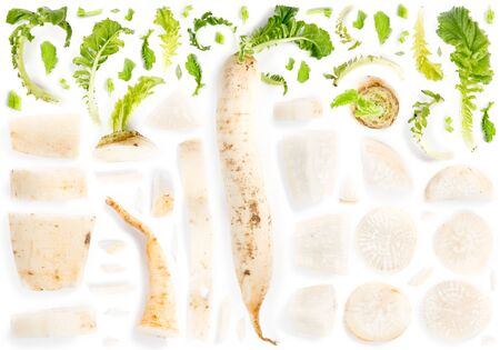 Large group of parsley root pieces isolated on white background. Seamless abstract pattern.
