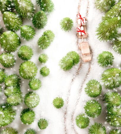 Car transporting gifts in the forest covered with snow. Christmas concept. White space for the text.