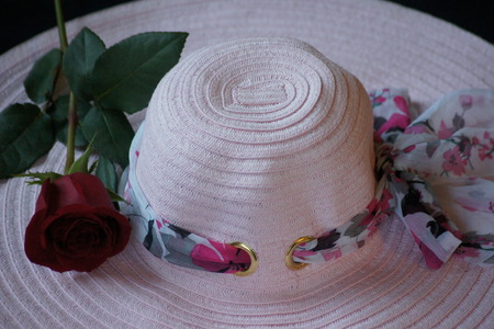 Woman s pretty pink garden hat with red rose  photo