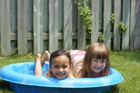 best: Two little girls (best friends) share pool.