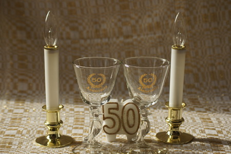 2 50: Antique 50th anniversary glasses with candles. Stock Photo