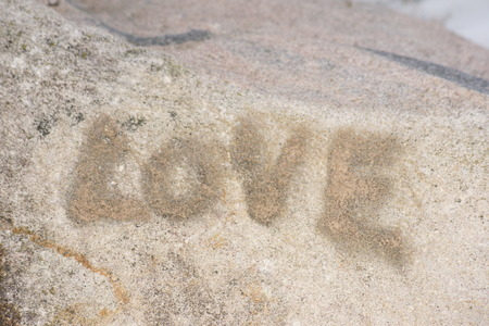 The word love on a large rock. Stock Photo