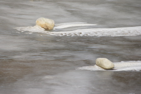 frozen lake: Two rocks in frozen lake. Stock Photo