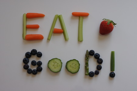 good: Words EAT GOOD! with strawberry.