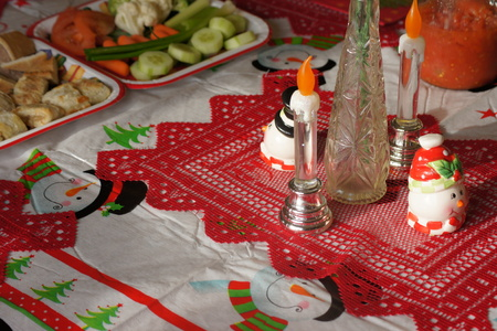feast: Christmas snacks on a festively decorated table. Stock Photo