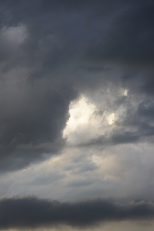 A mixture of darkening and white clouds consume the sky with the promise of a storm.