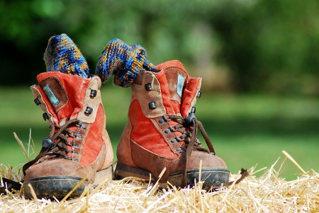 Trekking shoes with socks on straw photo