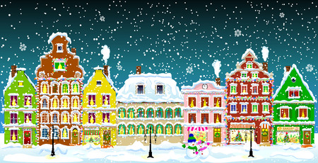 City street in the winter night. Christmas Eve. Winter holiday. Houses in winter night. Snow on a city street. Decoration houses on winter holidays.