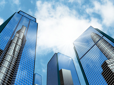 Modern high-rise buildings against the sky. Skyscrapers of the business district. Stock Photo