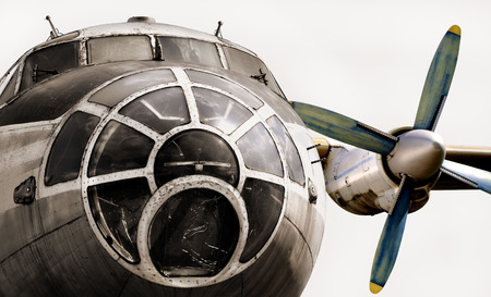 Old plane isolated. The nose of the aircraft, cockpit and aircraft engine.