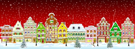 Winter night in the old town on the eve of Christmas. City street in winter. Christmas Eve. The houses are covered with snow. Snow on a city street. Houses decorated before the winter holidays. Snow-covered city street.                                                                                                              스톡 콘텐츠