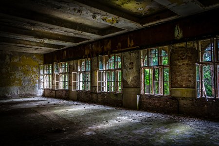 abandoned room: The suns rays break the darkness in an abandoned destroyed room of an ancient building
