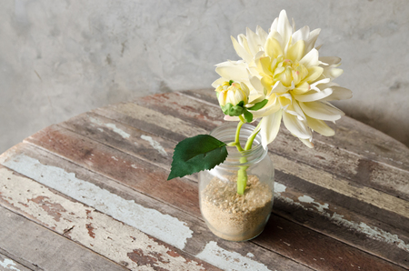 artificial flower: Yellow Artificial Flower decorated on wooden table