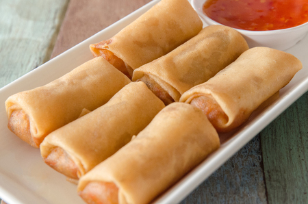 appetizers menu: Fried spring roll, served with dipping sauce.