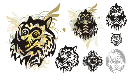 Tribal monster wolf head with splashes and the head of the monster. Set of the heads of the monster for a carnival. Tribal grunge wolf head with floral splashes and blood drops