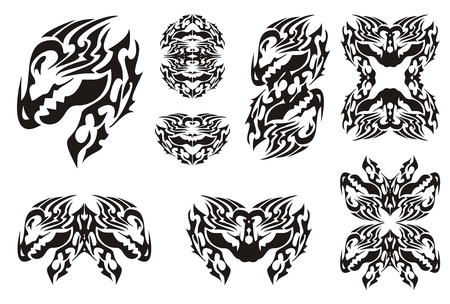 Horned dragon set in tribal style. Symbols of the dragon head and dragon frames isolated on a white background Vector