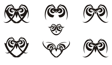 Tribal black and white laconic owl icons. Linear decorative icons of owls formed by your elements for your design