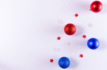 Christmas composition. Christmas red and blue decorations on white background. Flat lay, top view, copy space for text.