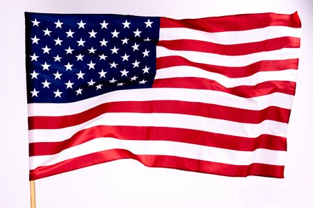 American flag background for Memorial Day or 4th of July with copy space. Or Independence Day background. Beautifully waving star and striped American flag.