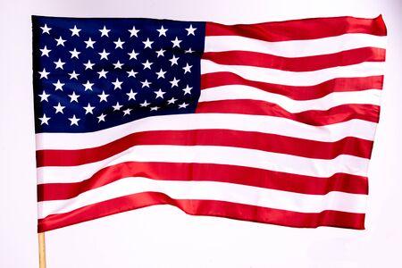 Fond de drapeau américain pour le Memorial Day ou le 4 juillet avec espace de copie. Ou fond de jour de l'indépendance. Étoile magnifiquement ondulante et drapeau américain à rayures.