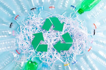 Top view of plastic bottles and paper shred. Recycle and World Environment Day concept.