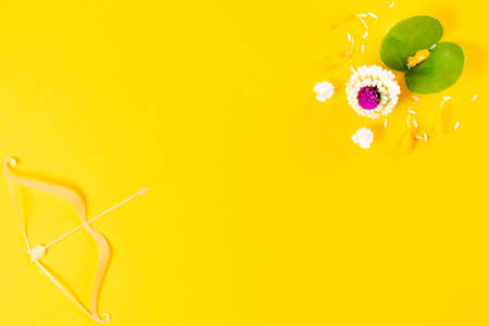 Happy Dussehra festival. The bow and gold arrow on yellow paper background with copy space for text.