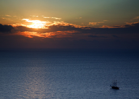 Sunset in the ocean with a boat